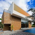 Biệt thự được tạo hình từ những khối vuông vững chãi nhưng sắc sảo